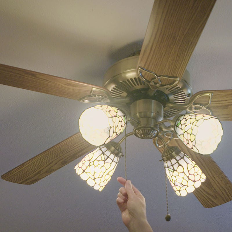 Hand Turning on Ceiling Fan